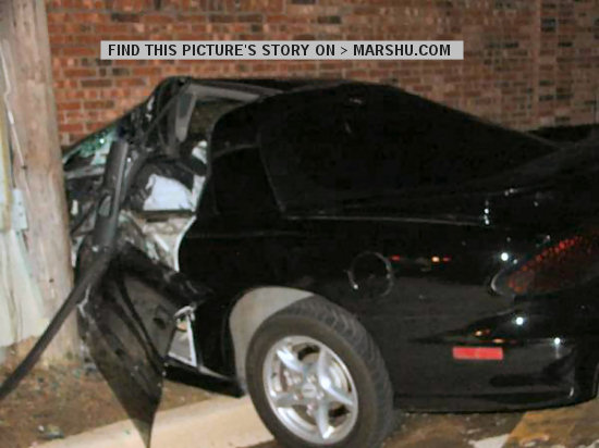 Car accident: driver's side door into a telephone pole