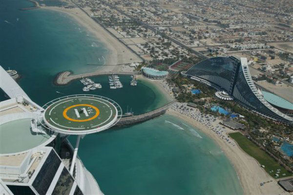 tiger woods hitting golf balls off the helipad at burj al arab sailboat hotel in arab emirates, dubai