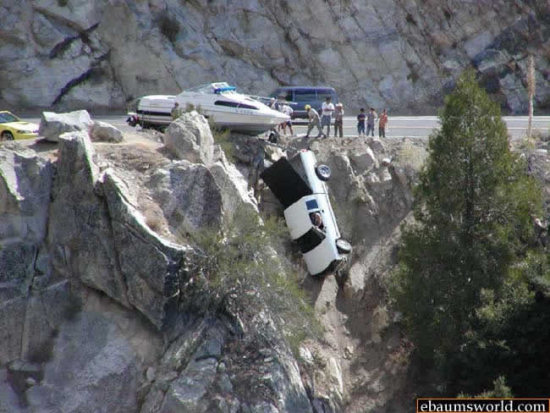truck hanging off a cliff with boat accident